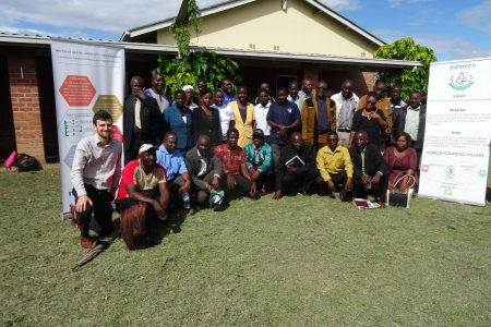 Participants pose for a photo after the LSC meeting in Zimbabwe