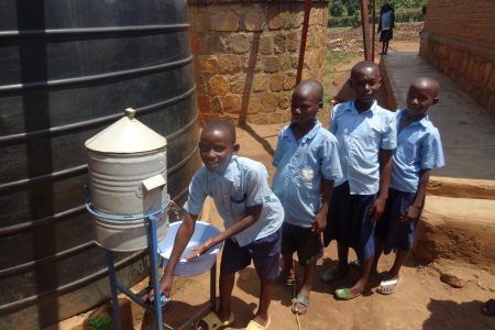 Pupils at Gorora Primary School wash their hands at the tippy tap
